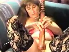 Mature Whore Masturbates With A Club
