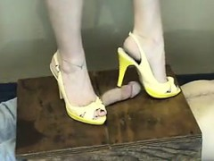 stepping-on-his-dick-with-high-heels-on