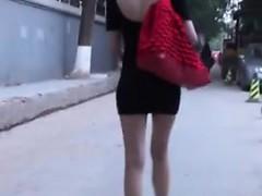 hot-oriental-woman-walking-in-minidress