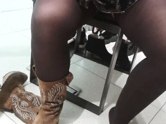 trying-on-some-boots-with-a-peak-between-the-woman-s-sexy-l