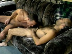 two-muscled-studs-lie-on-the-sofa-for-a-round-of-cocksucking-and-ass-fucking