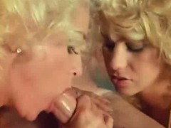 Two Blondes Licking Cock In Classic Porn
