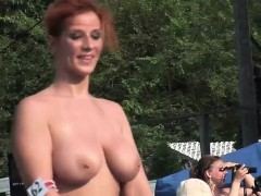 ravishing-redhead-performs-striptease-in-public