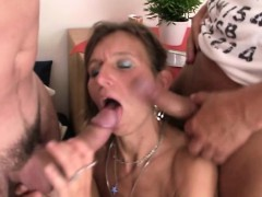 mature-woman-in-fishnets-swallows-two-dicks