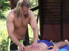 muscular-blonde-massage-guy-trent-massaging-joel-vargas