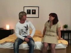 Redhead old woman in stockings rides him