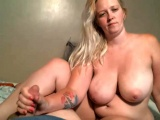 Blonde chick with big boobs gives handjob