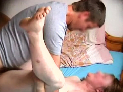 wife has a younger guy plowing her cunt on the bed