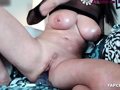 oiled-milf-harlot-playing-with-her-fake-dick