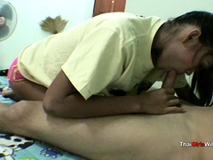 Skinny Thai whore licks and blows big dick