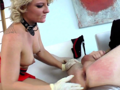 strapon-clad-domina-jerking-losers-cock