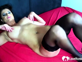 Busty chick in stockings wants some attention