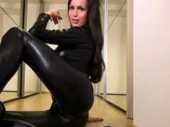 cute babe in shiny black catsuit