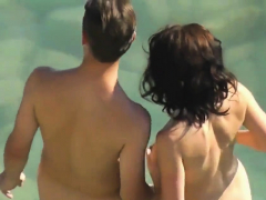 horny-couple-have-sex-by-the-ocean-nudist-beach