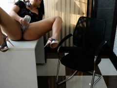Naughty Asian masturbates while she's in the office