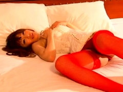 japanese babe gives a footjob in stockings