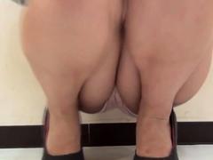 Asian In High Heels Urinates Over Floor