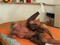 Blonde 70 years old grandma in black stockings