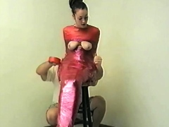 Horny Japanese MiLF in red latex with a strap on