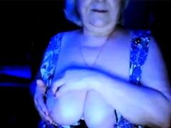 hot-granny-flashing-her-big-tits-of-her-husband-hidden