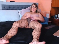 Shemale Playing with her cock and balls