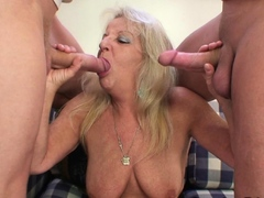 Old granny takes two huge dicks from both sides
