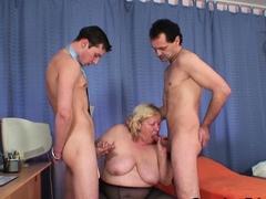 Huge boobs grandma swallows two cocks at once