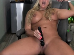 Hot muscular milf fucks her shaved pussy with a vibrator and