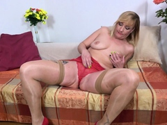 Curvy mature Goldie takes off her white panties
