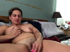 amateur-busty-blonde-plays-with-toys-to-relax